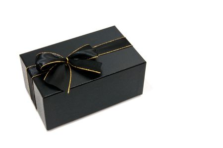 Black giftbox with a black and gold knot white isolated photo