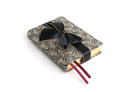 A fancy appointment book wrapped witn a black bow as a gift Stock Photo - 6354776