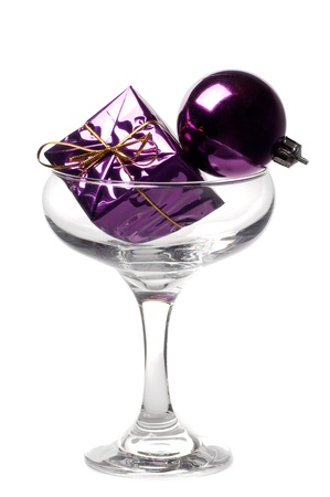 Concept of a Christmas gift and a ball in a glass Stock Photo - 8386349