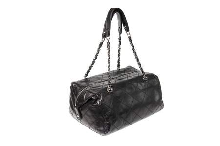 Womens black quilted leather handbag white isolated photo