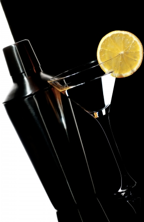 martini shaker: Shaker and cocktail in martini glass on a  white and black background