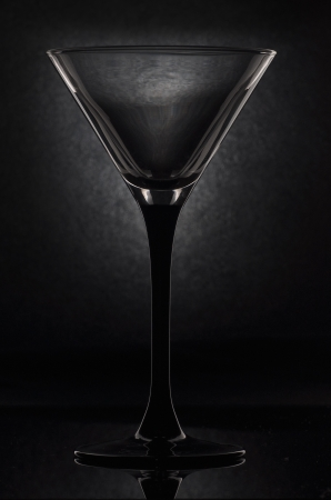 martini glass: empty martini glass on a black background