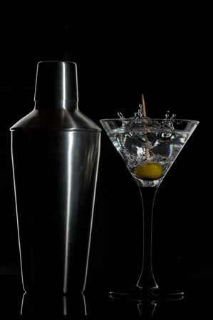 martini shaker: martini cocktail and a shaker on a black background  Stock Photo