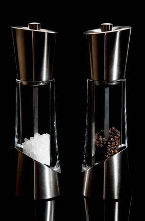 salt pepper:  Fancy salt and pepper mills on a black background Stock Photo