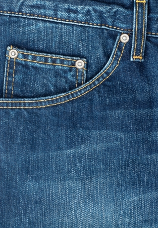 old macro: close up up of fancy washed  blue jeans  pocket