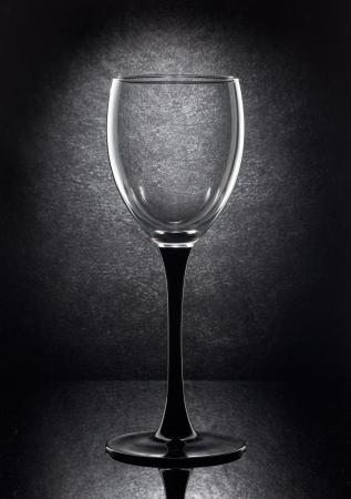 empty wine glass on a black background photo
