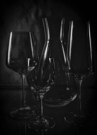 high contrast wine glasses on a black background