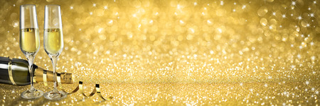 Champagne Toast New Year banner, golden background