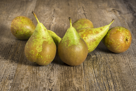 Conference pears on rustic wood