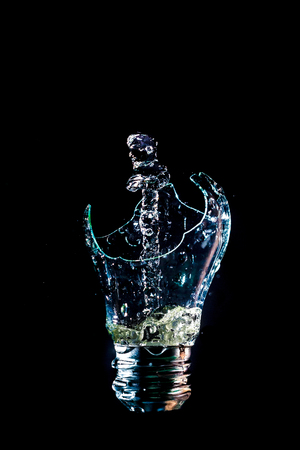 Creative broken light bulb with water fountain Banco de Imagens