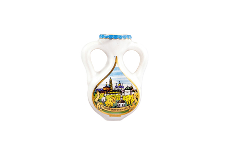 ceramic souvenir toy in the form of jug with beautiful color painting on isolated white background reflecting the national Russian culture with the inscription in Russian: The Trinity-Sergius Lavra