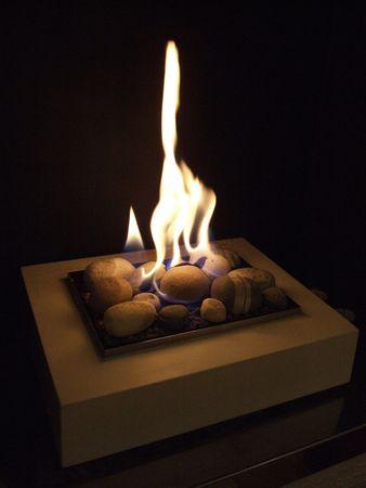 warm gas fire in a homly fireplace Stock fotó