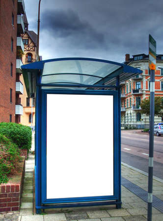 billboard posting: A high dynamic range image of a bus stop with a blank bilboard for your advertising