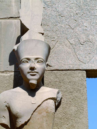 An ancient statue in the karnak temple complex at luxor in Egypt. photo
