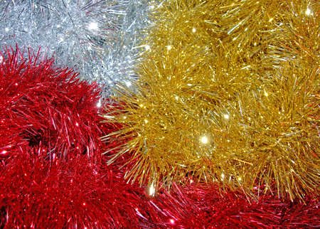 three colours of tinsel that makes a sparkly christmas background photo