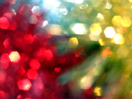 three colours of blurred tinsel that makes an abstract christmas background photo