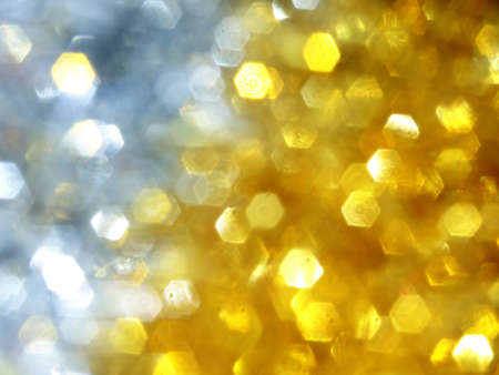 two colours of blurred tinsel that makes an abstract christmas background photo