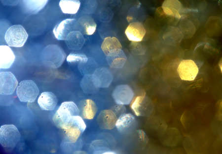 two colours of blurred tinsel that makes an abstract christmas background