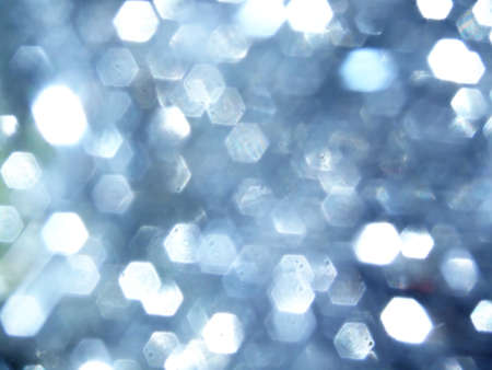 blurred silver tinsel that makes an abstract christmas background photo
