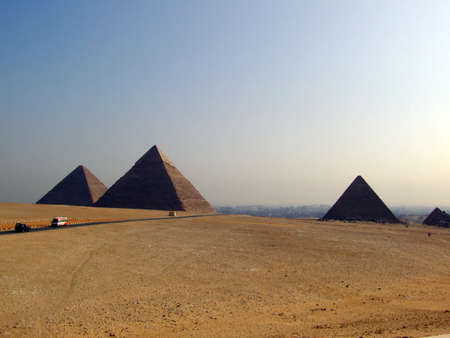 chephren: the great pyramids of giza in Egypt with cairo in the background Stock Photo