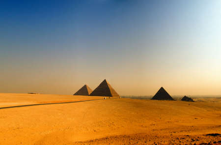 egyptian mummy: the great pyramids of giza in Egypt with cairo in the background Stock Photo