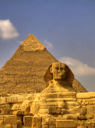 giza: The Sphinx guarding the pyramids on the Giza plateu in Cairo, egypt.