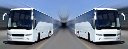 Two white tour buses set against a motion blurred background