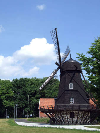 An old windmill building by a farmyard in a countryside setting. Stock Photo - 5053069