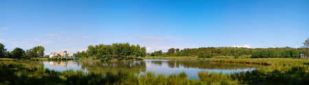 A panoramic view of a countryside lake with house near the swedish town of Torekov in the skane region of the country.