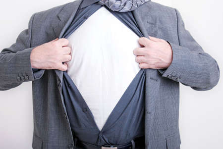 A business man tears open his shirt in a hero fashion getting ready to save the day. Stock Photo - 5959490