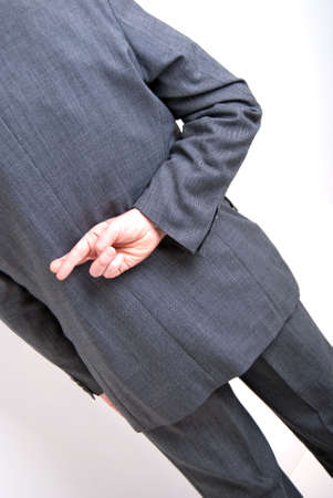 A conceptial image of a business man with his fingers crossed behind his back. Stock Photo - 5959504