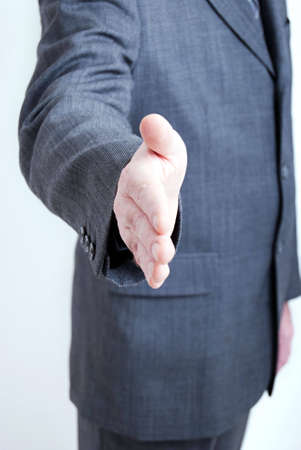 A business man makes a hand shake gesture in your direction. Stock Photo - 5959505