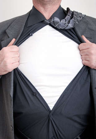 open shirt: A business man tears open his shirt in a super hero fashion getting ready to save the day.
