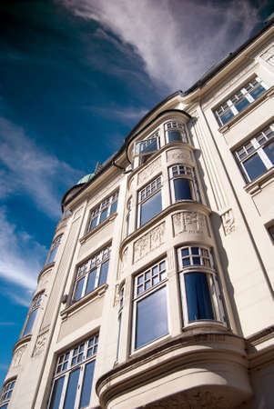 architectural detailing: Hotel luxury apartments set against a blue sky and wispy clouds background Stock Photo