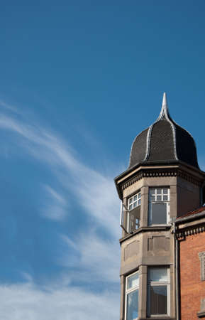 architectural detailing: apartments set against a blue sky background with room for your text