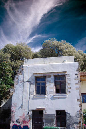 kreta: A view of an old crumbling building in the greek town of Chania.