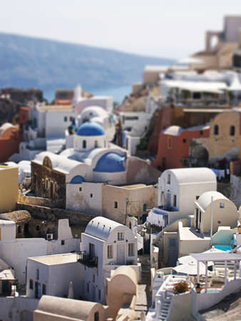 A tilt-shift effect applied to an image of the greek town of Oia on the island of Santorini. This gives the illusion of the buildings being miniature models photo