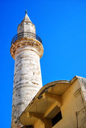 kreta: A view of the mosque at the port of chania on the Greek isle of Crete Stock Photo