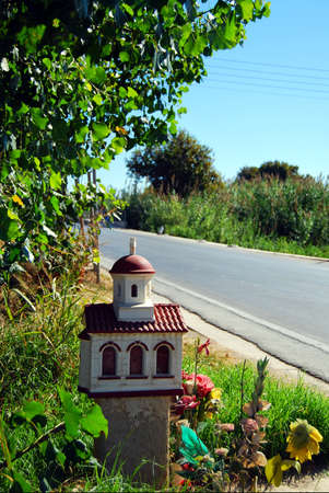One of the many roadside shrines situated on the greek island of crete that sadly commemorates a tragic traffic death of an individual at that specific location. Stock Photo - 7091020