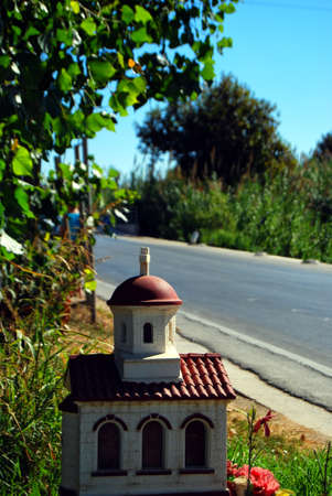 One of the many roadside shrines situated on the greek island of crete that sadly commemorates a tragic traffic death of an individual at that specific location. Stock Photo - 7091017