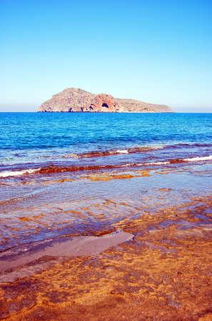 The small island of Theodori Nisida as seen from the greek island of Crete. photo