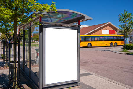 An image of a bus stop with a blank bilboard for your advertising situated in the swedish town of Bastad. Stock Photo