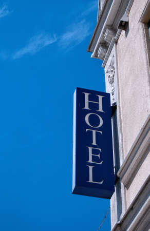 hotel sign: An unlit neon hotel sign situated on the building exterior.