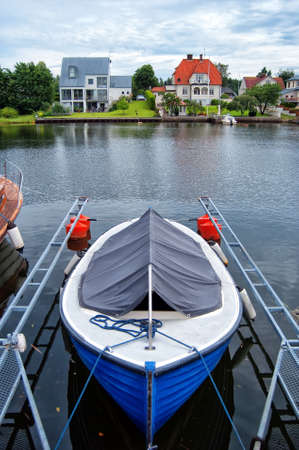 peacefulness: An image depicting the peacefulness of life by the riverside in the quiet swedish town of Ahus.