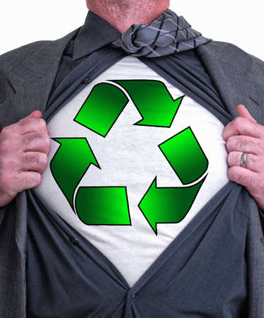 A business man isolated against a white background tearing open his shirt to reveal a recycle sign on a t shirt Stock Photo - 7994082