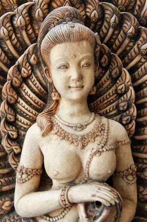 A buddhist carving typical of the sort that adorns the outside of homes or shops in Thailand. Stock Photo - 8129072