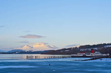 A view of loch lomond with paddle steamer in the foreground photo