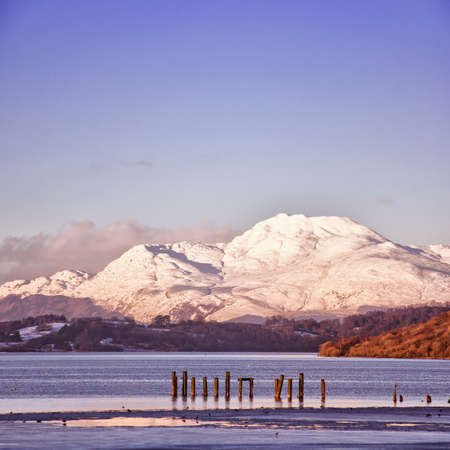 A view of the majestic and impressive ben lomond from across loch lomond near the scottish town of balloch. photo