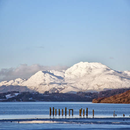 loch lomond: A view of the majestic and impressive ben lomond from across loch lomond near the scottish town of balloch.