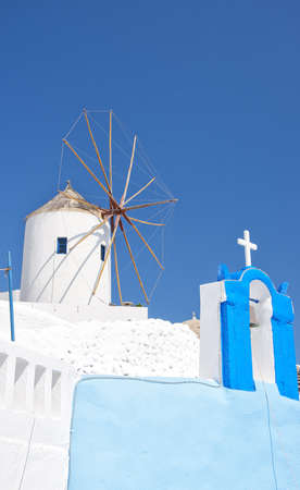 One of the traditional windmills of Oia on the greek paradise island of Santorini. photo